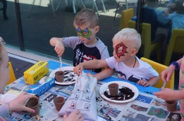 Eli and Lauchlin plant their own seeds from the Grimsby Grows Seed Library