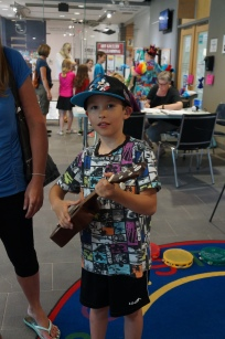 Rory plays the ukulele with the Fun School of Music