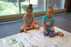 Sophia and Aaliyah get creative at the giant colouring page