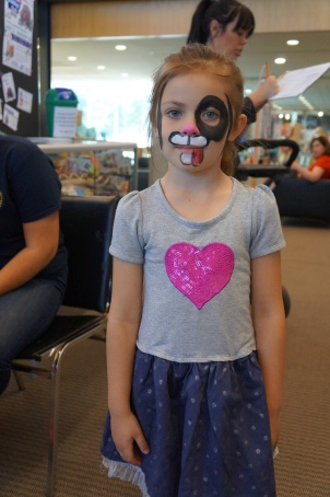 Taya magically turned into a puppy at the Facepainting station